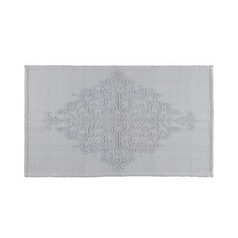Bath mat with raised decoration