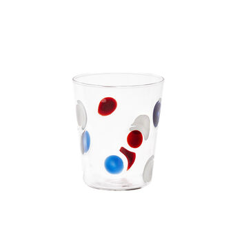 Glass tumbler with polka dot decoration