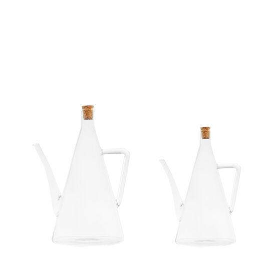 Glass oil bottle with cork stopper.