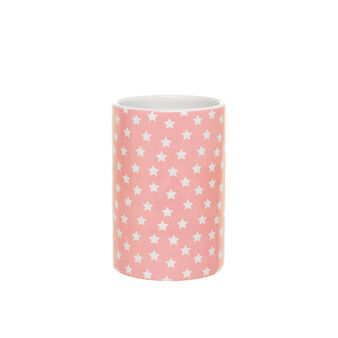 Pink ceramic toothbrush holder with small stars pattern