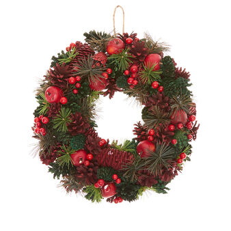 Decorative wreath with berries and apples