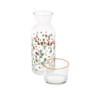 Glass carafe with flowers decoration