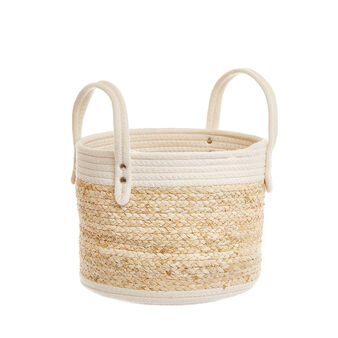 Round basket in leaves and rope