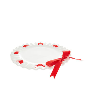 Ceramic serving dish with red ribbon