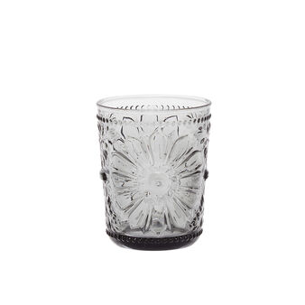Glass tumbler with flower decoration