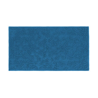 Cotton bath mat with raised motif