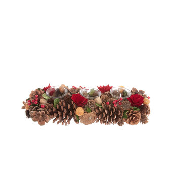 Hand-made centrepiece with flowers and pine cones and votive candles