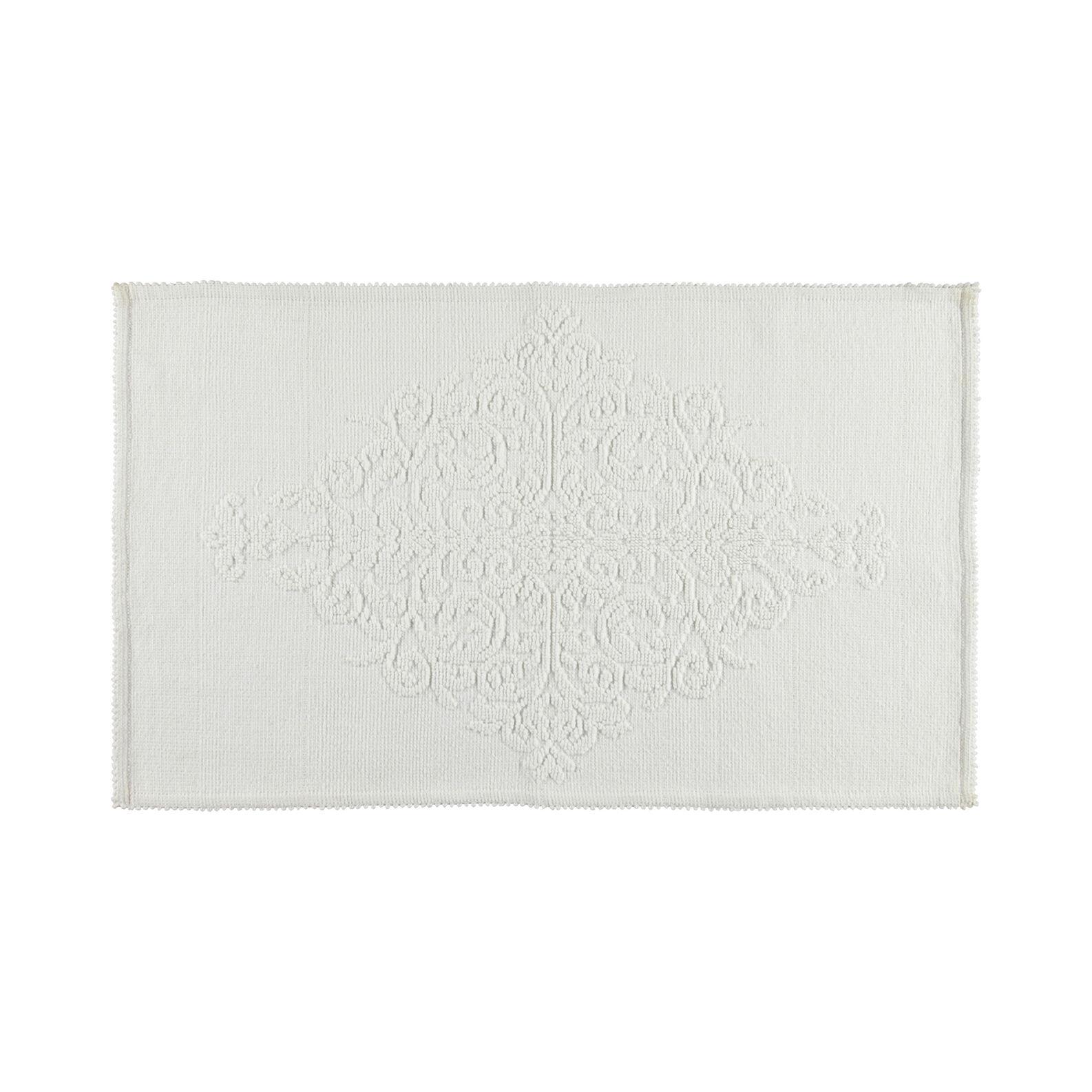 Bath mat with raised decoration