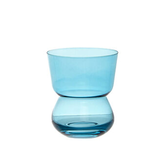 Glass of water colored glass in paste