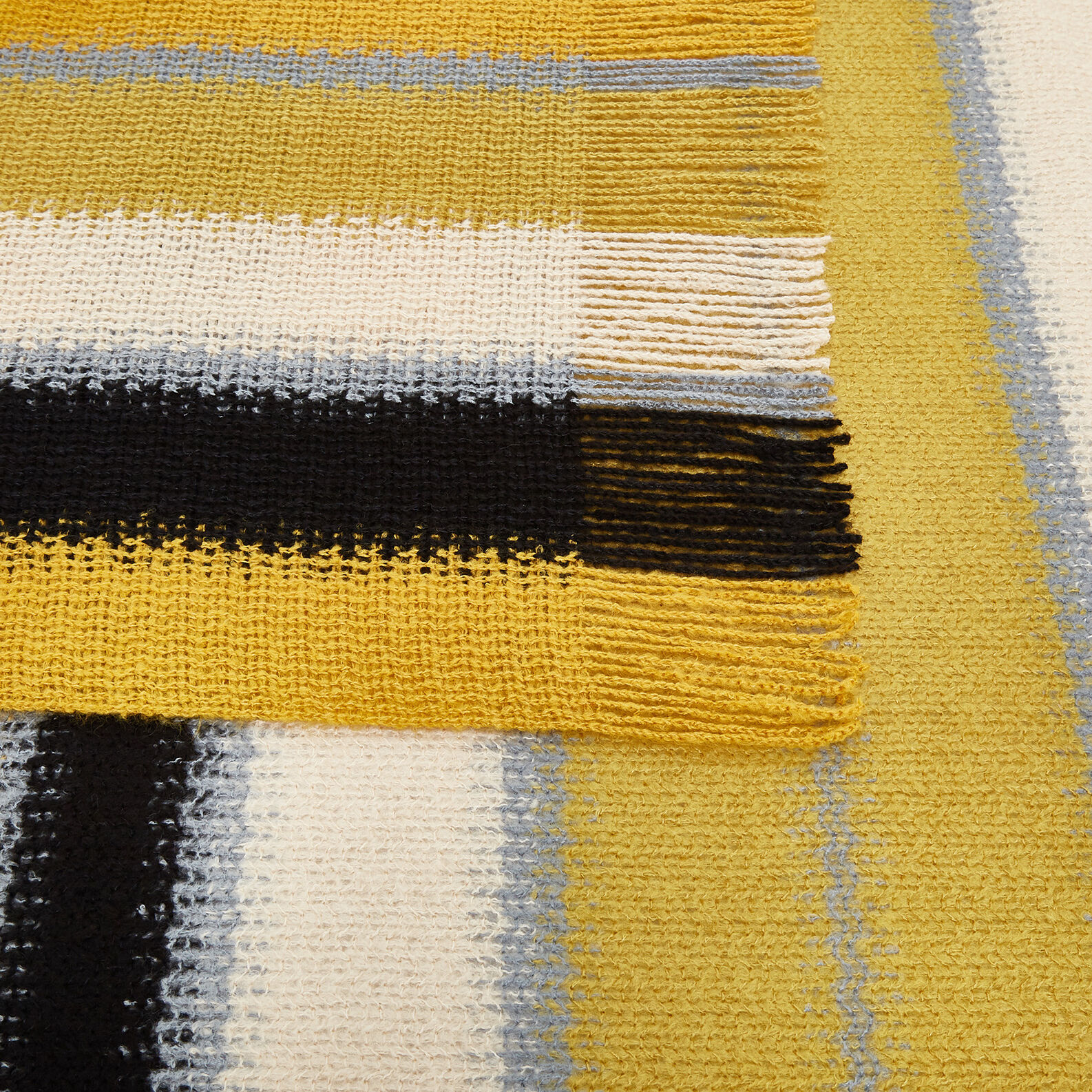 Throw with striped design