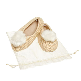 Knitted slipper with faux fur pompom