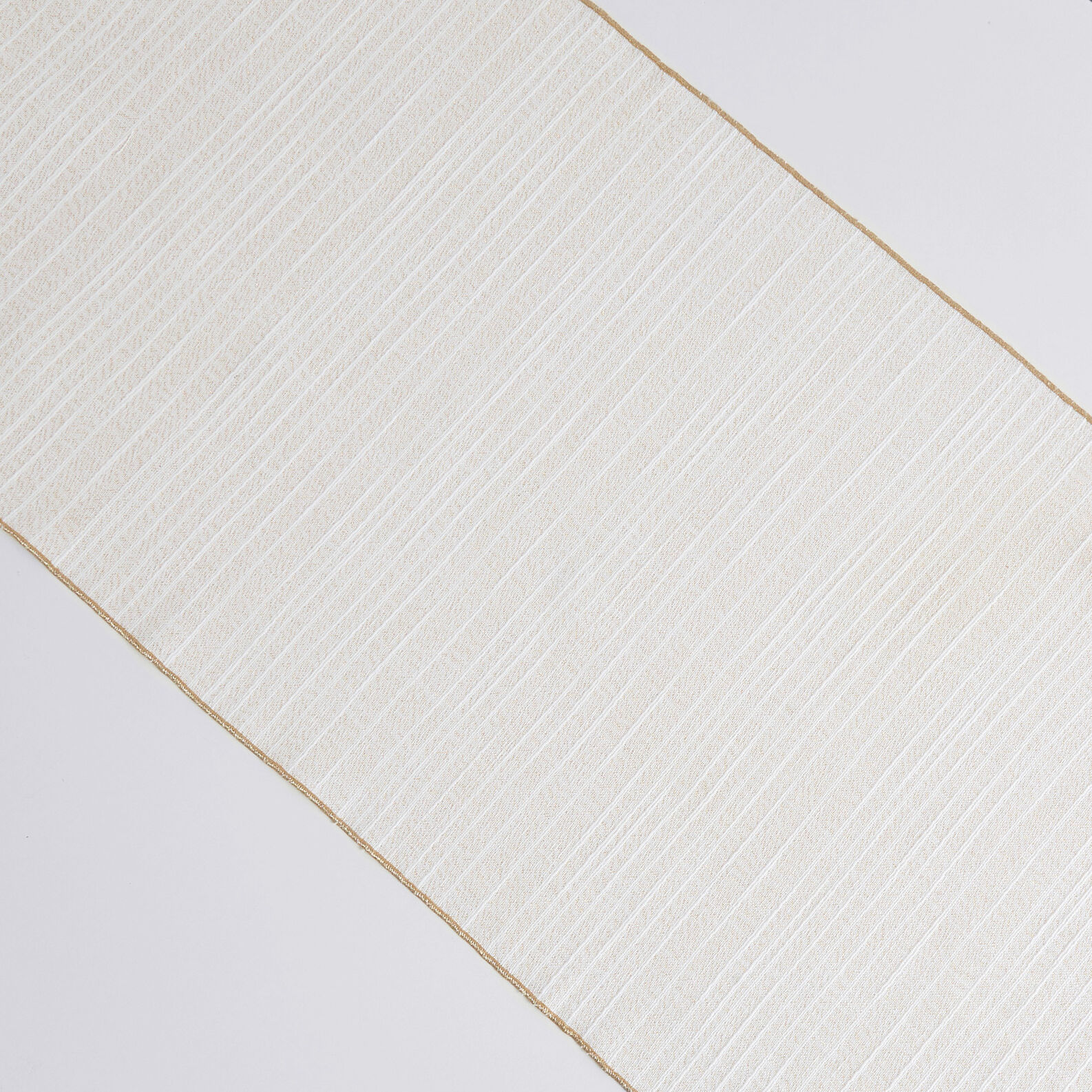 Flamed cotton table runner with lurex hem