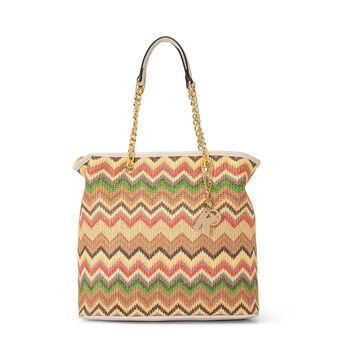 Bi-material bag with herringbone design