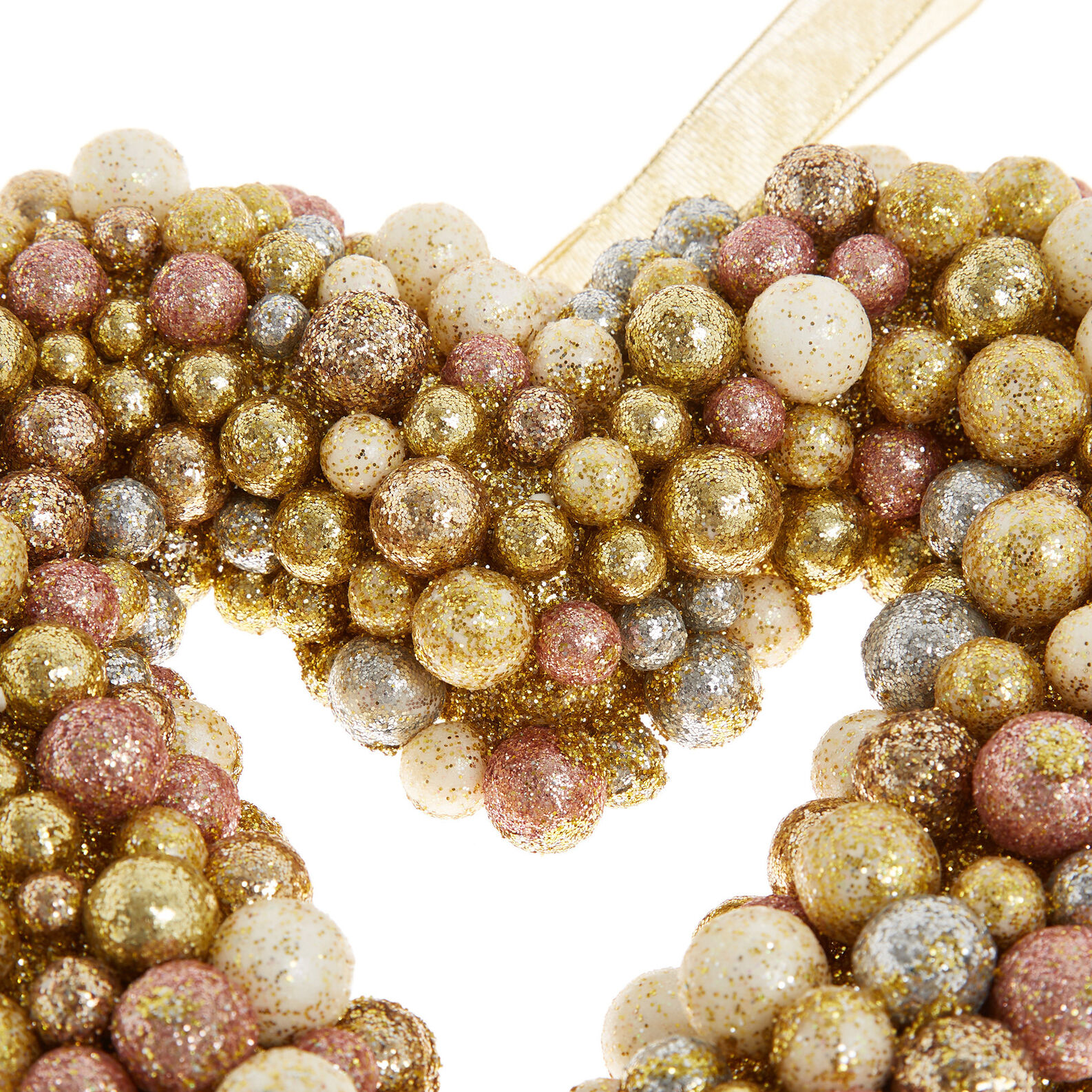 Heart-shaped wreath with glitter berries