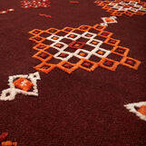 Hand-woven wool rug with kilim motif