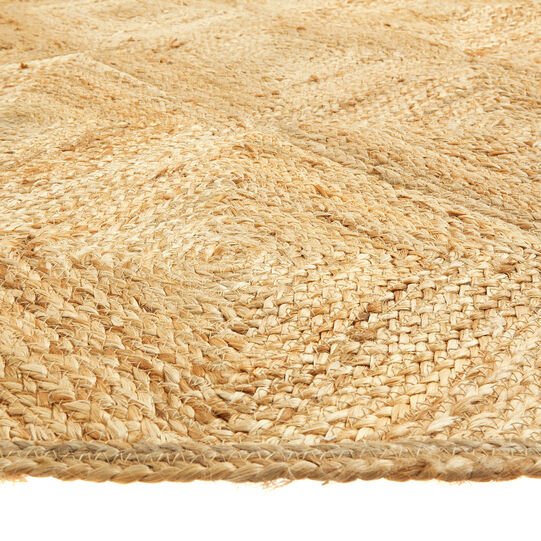 Woven jute mat with geometric motif
