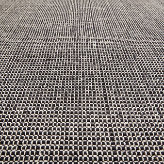 Hand-braided mat in cotton