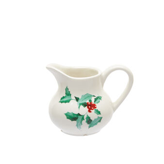 Ceramic milk jug with holly decoration