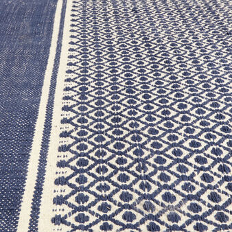 Hand-woven rug in jacquard cotton