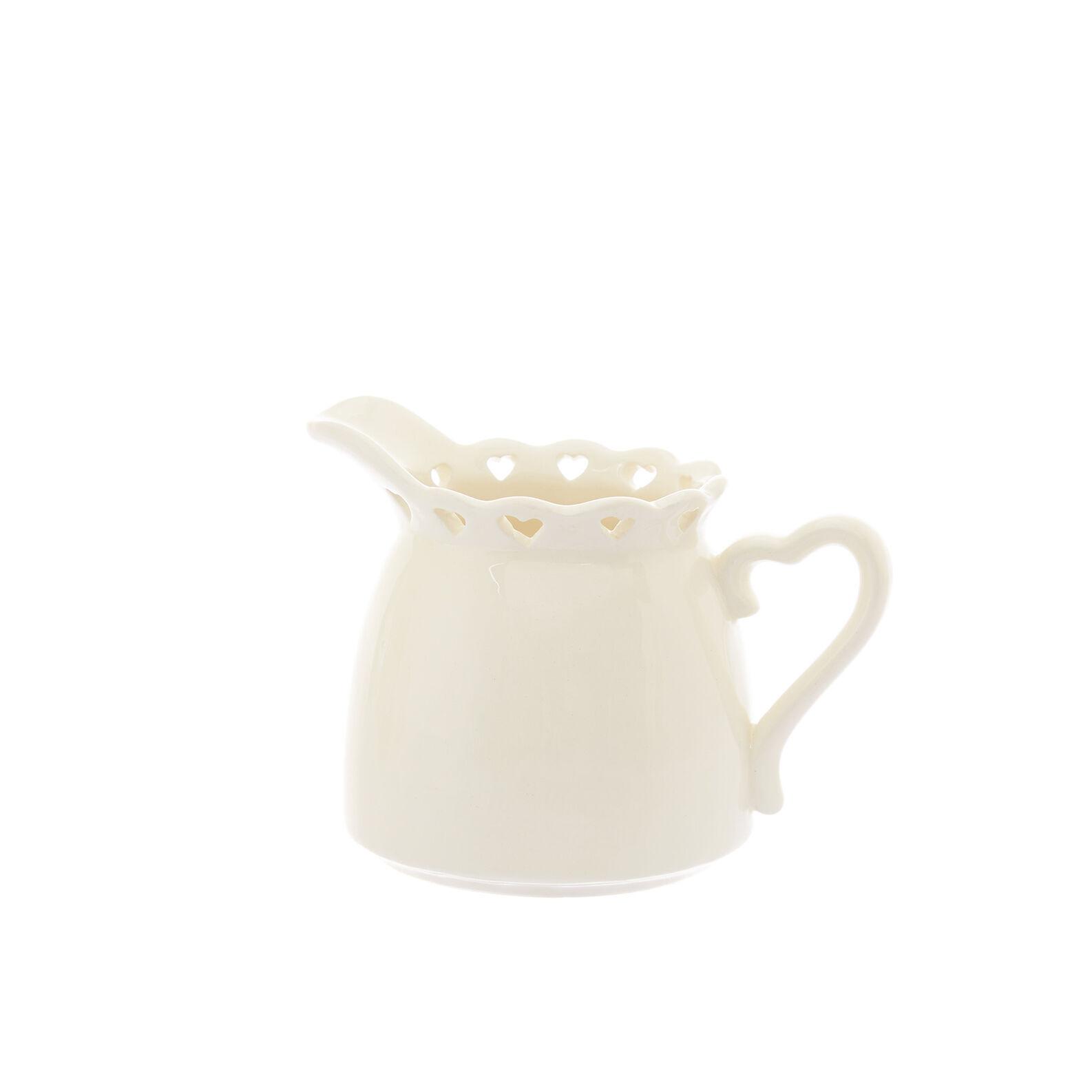 Ceramic milk jug with openwork heart design