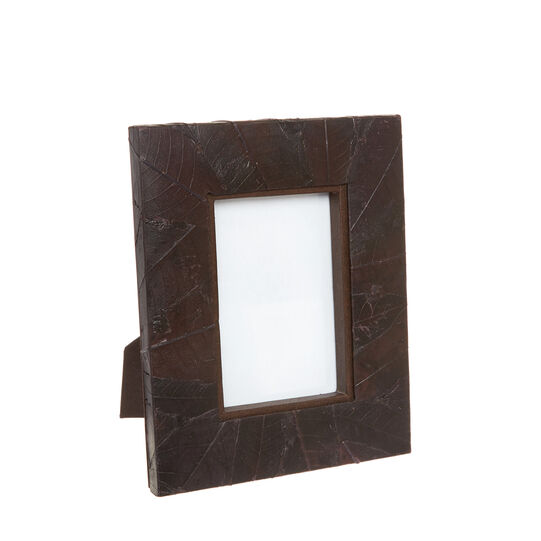 Handmade photo frame with mango leaves