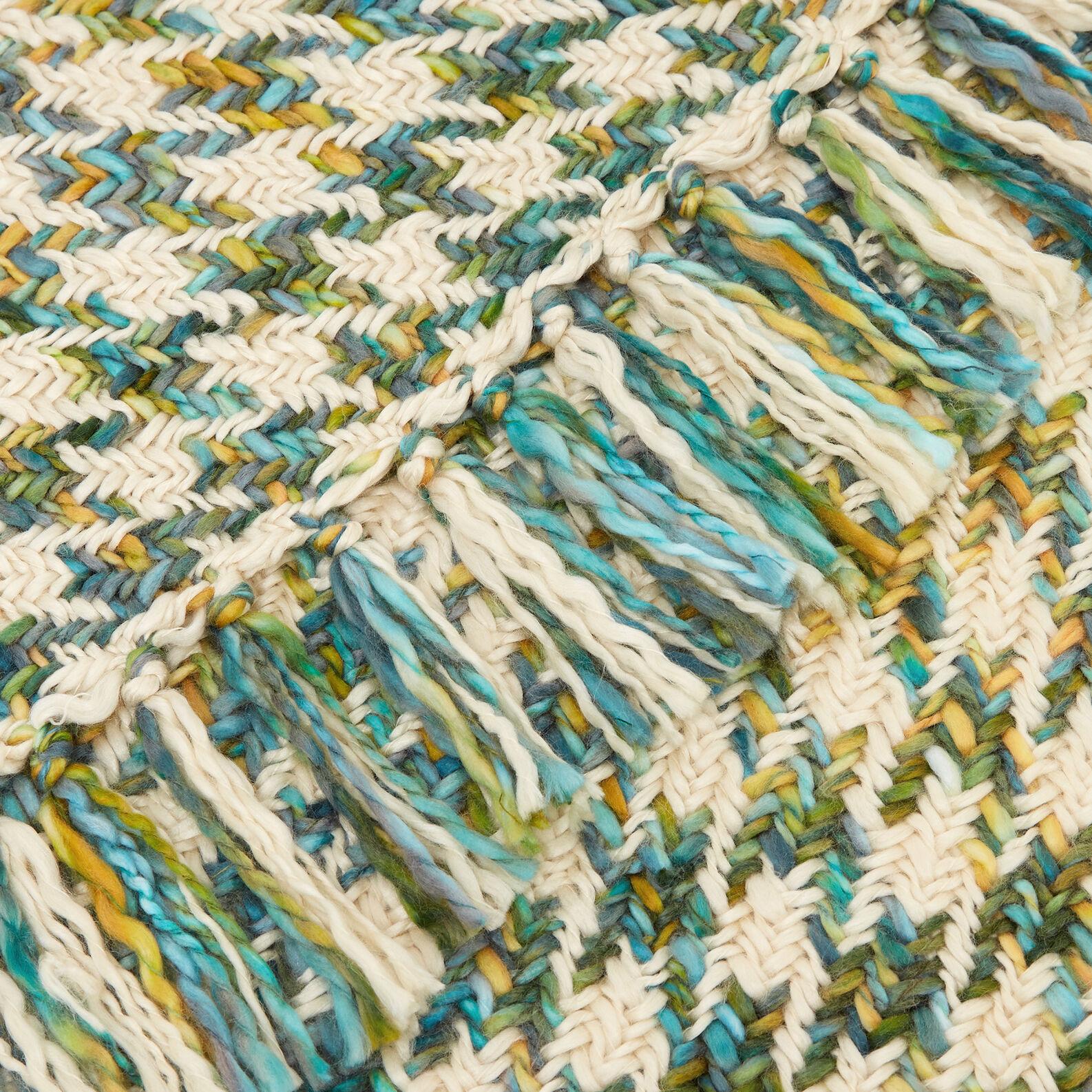 Plaid in maglia con frange