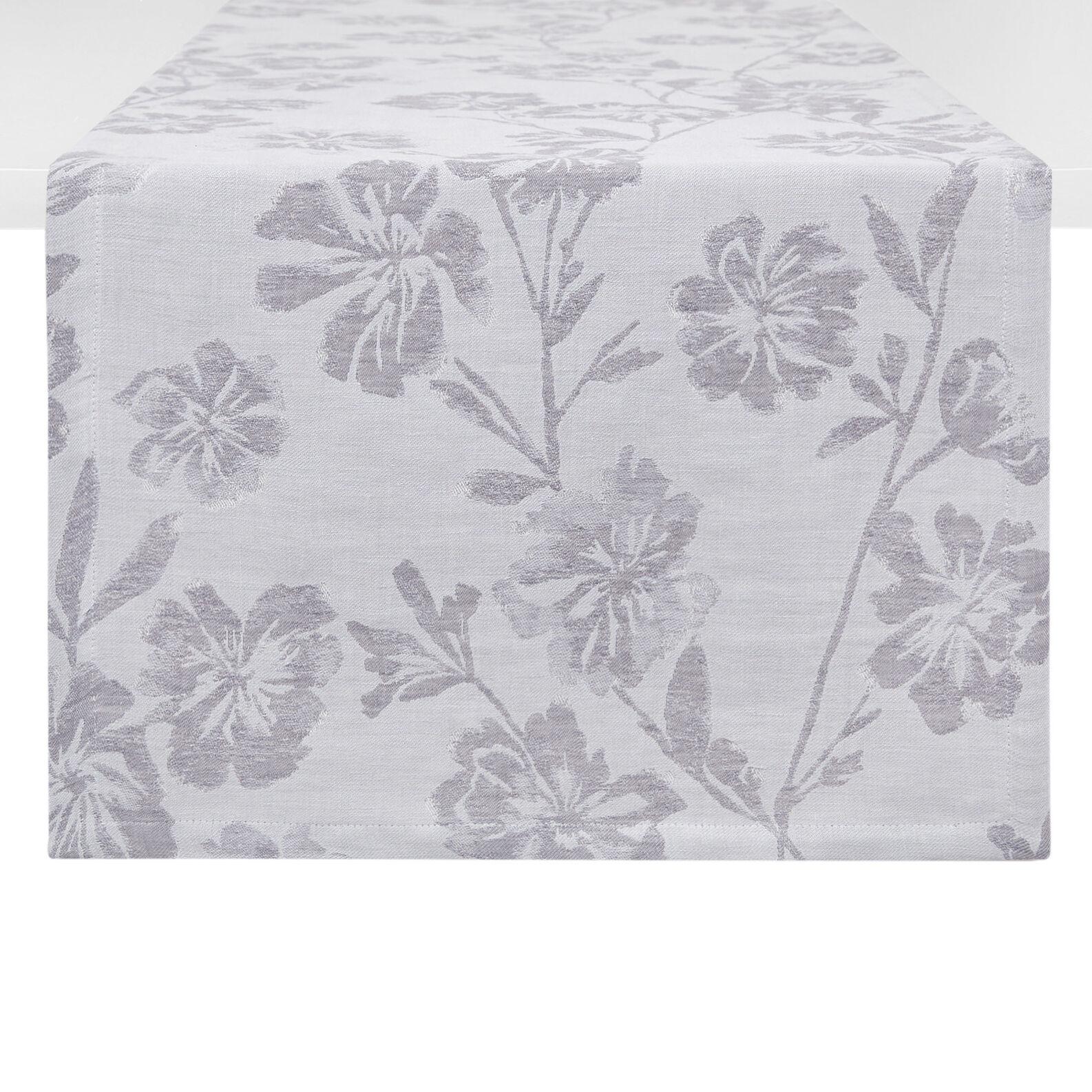 Linen blend table runner with floral motif