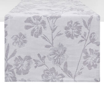 Linen blend table runner with floral motif