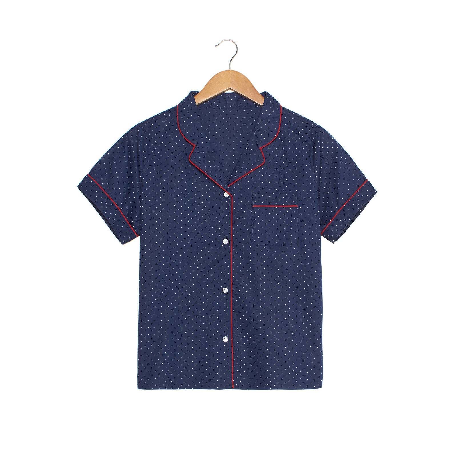 Polka dot shirt with contrasting piping and short sleeves.