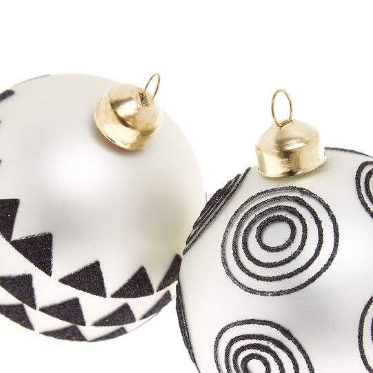 Hand-decorated bauble with triangles
