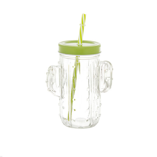 Glass mug with drinking straw and cactus