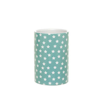 Light blue ceramic toothbrush holder with small stars pattern