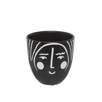 Ceramic cachepot with face decoration