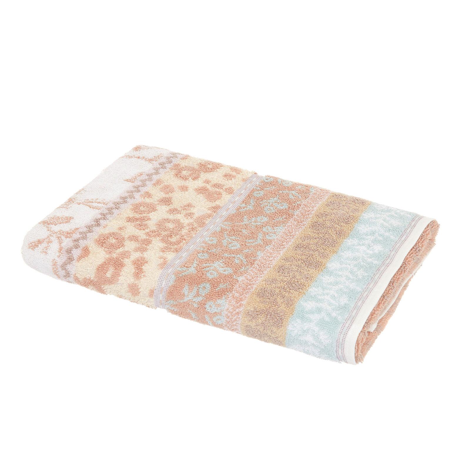 Cotton towel with floral jacquard design