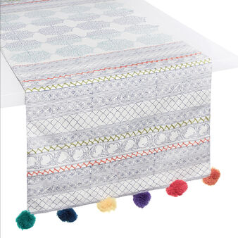 100% cotton table runner with small frames and pompoms