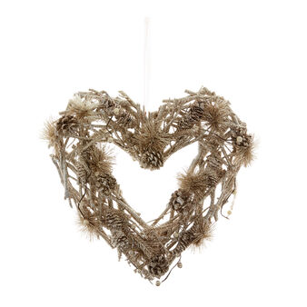 Decorative heart with glitter branches and pine cones