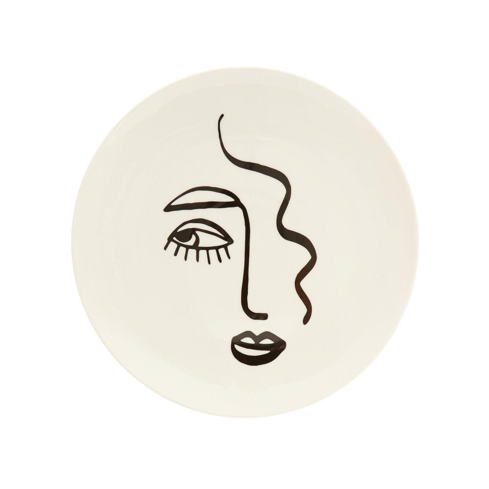 Porcelain serving dish with face motif