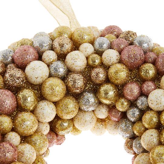 Corona con bacche glitter