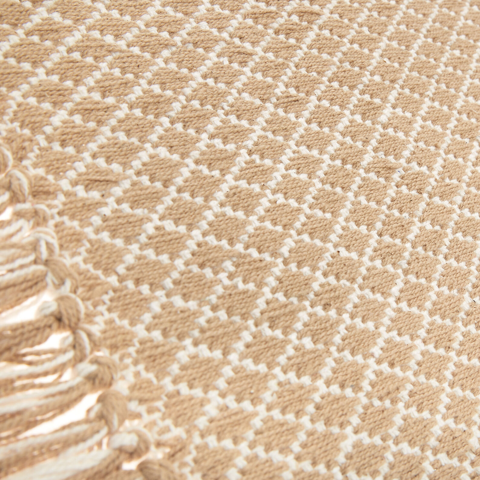 Hand-woven cotton kitchen mat with fringing