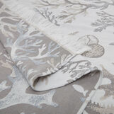 Cotton jacquard beach towel and sarong with coral design