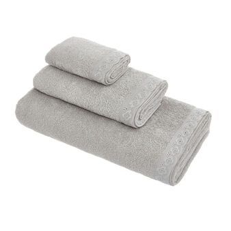 Cotton terry towel with broderie anglaise